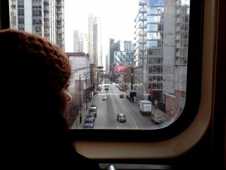 Girl hat downtown city train window 320x240